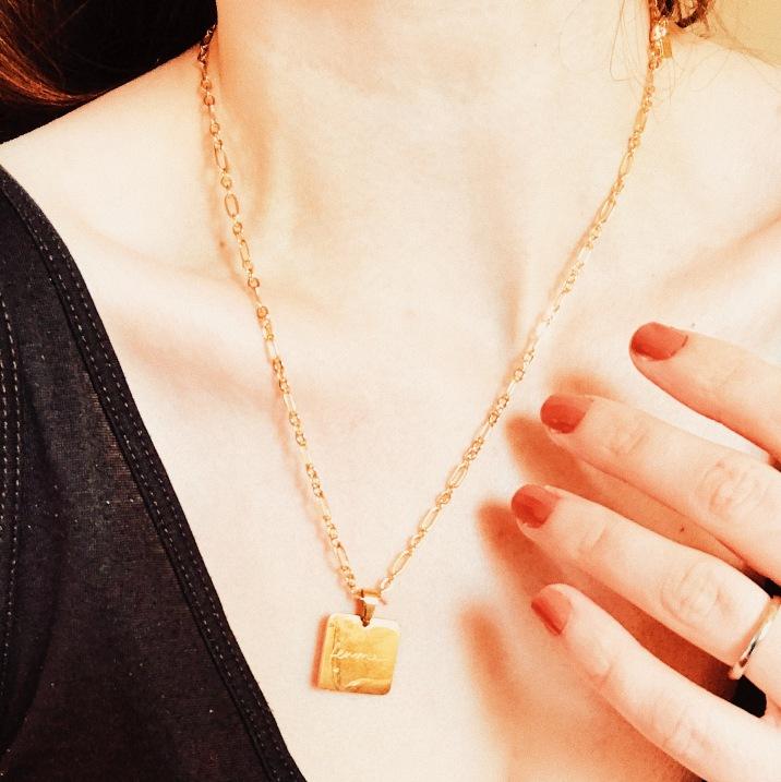 Cendré gold plated 'Femme' necklace.